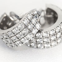 Brilliant cut three row diamond hoop earrings set in 18 carot white gold - £5,000